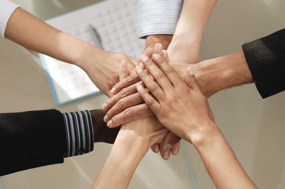 businesshandinmiddle-629x945